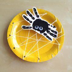 Handprint spider paper plate spiderweb craft for halloween