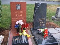 """Brandon's  gravestone, designed by North Snohomish County sculptor Kirk McLean, is a tribute to Lee and Hutton. Its two twisting rectangles of charcoal granite join at the bottom and pull apart at the top. """"It represents Eliza and Brandon, the two of them, and how the tragedy of his death separated their mortal life together"""", said his mother, Linda Lee Cadwell, who described her son, like his father before him, as a poetic, romantic person"""