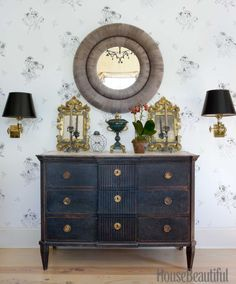 A mirror from Balsamo is flanked by a pair of Italian gilded wood mirrors on a chest of drawers from Cupboards & Roses Swedish Antiques.