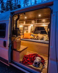 This van looks so cozy on the inside! It makes me want to live in a camper! Plus I love that mini stove! #vanlife