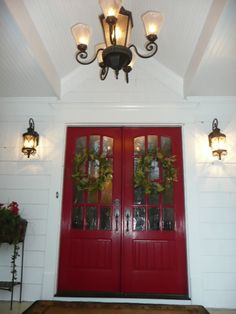 red double doors and black light fixtures for the porch