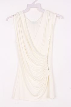 Pretty Top in Soft Ivory with a tummy flattering style. I really like this style.