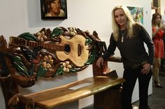 Cherie Currie of the Runaways stands with the wooden bench she made in memory of Kelly Thomas. He was a mentally ill homeless man beaten to death by 6 police officers.