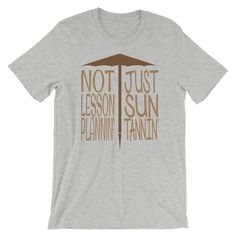 Summer vacation or spring break means this teacher is taking a rest from their usual lesson plans and grading homework to trade it in for time on the beach working on their suntan. This funny teacher summer break design says Not Lesson Plannin Just Sun Tannin under an umbrella graphic. This t-shirt is everything you've dreamed of and more. It feels soft and lightweight, with the right amount of stretch. It's comfortable and flattering for both men and women. • 100% combed and ring-spun cotton (h Teacher Summer, Teacher Tools, Last Day Of School, Spring Break, Homework, Lesson Plans, Spun Cotton, Feels