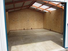 Then we clad the walls with 11mm OSB.  We had to remove the spaces behind the floor anchor brackets.  Before fitting the OSB we ran electrics for sockets around two walls of the garage.