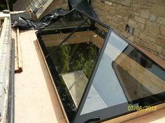 Slimline roof lantern - frameless design...aluminium trims...very contemporary.....