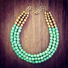 I have this and lOvE it! They are actually very lightweight wooden beads. Beautiful! Mint and Gold Statement Necklace  by icravejewels on Etsy, $58.00