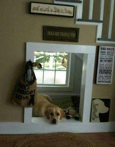 """Mais uma super ideia pra usar o vão da escada: casinha pros cachorros. Essa é nova!    ..e concordamos com a frase da casa: """"cachorros são pessoas também""""! Devem ser tratados com o mesmo respeito e carinho."""