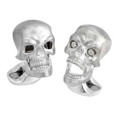Brand new pair of sterling silver Deakin & Francis cufflinks, featuring skulls with moving jaw and diamond eyes. Come with box and booklet  DESIGNER: Deakin & Francis  MATERIAL: Sterling Silver  GEMSTONE: Diamond  DIMENSIONS: Top measures 20mm x 14mm.  WEIGHT: 23.7g  MARKED/TESTED: Deakin & Francis,925  CONDITION: New  PRODUCT ID: 14207