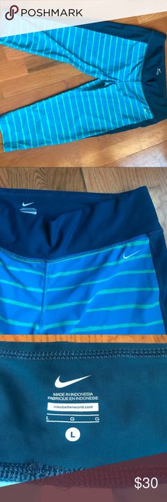 Nike workout capris Bright blue workout capris with green stripes and navy side panel,82% nylon 18% spandex Nike Pants Leggings
