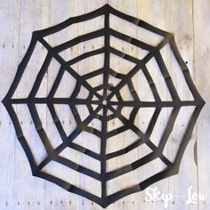 Easy tutorial on how to make a paper spider web by cutting and folding paper. A Kirigami spider web, the perfect Halloween decoration. MichaelsMakers Skip To My Lou