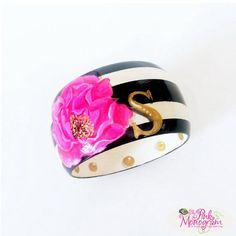 """Here Comes The BLOOM"" Hand Painted Bangle We think this hand painted bangle is simply perfect with its mix of black and white with a hot pink flower and gold initial. www.thepinkmonogram..com"