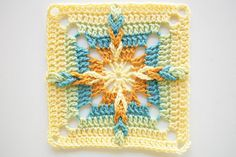 """Pattern: Square 54 from Leisure Arts 99 Granny Squares to Crochet Hook used: J Finished size: 8"""" Colors Used: Michael's Loops and Threads Impeccable Worsted in Soft Fern, bronze, and aqua. Hobby Lobby's I love this yarn in Buttercup. This square is so cool! You create these loops that stay..."""