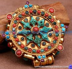 Handmade Tibetan Buddha Eight Sacred Buddhist Symbols Gau Box Pendant. This buddha gau box pendant was handmade in Tibet from sterling silver, turquoise and coral.