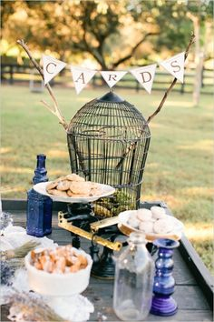 cards birdcage on the treats table #weddingideas #weddingdetails #weddingchicks http://www.weddingchicks.com/2014/04/07/rustic-lush-lavender-wedding/