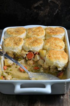 Chicken Pot Pie with Biscuits Recipe - Ultimate comfort food that is simple to make and delicious to eat! from addapinch.com