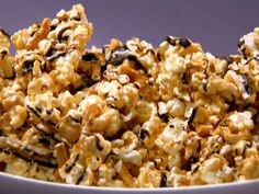 Awesome dessert popcorn! I tweak it a bit by adding about double the peanut butter (who doesn't love more peanut butter?) and use almond bark instead of melting down regular chocolate.  This stuff is addicting!