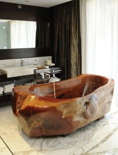 Have a relaxing soak in a wooden bathtub. Try something different than the common white tub and have your own spa at home. I have nev...