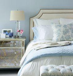 master bedroom look - upholstered headboard, mirrored nightstand, clear lamps
