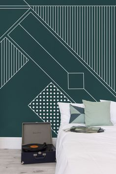 Sink into deep emerald tones with this Art Deco wallpaper. Combining high design with classic graphics, this wallpaper will bring instant dazzle to your home. Pair with metallic accents for a truly extravagant feel.