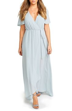 """Show Me Your Mumu Flutter Sleeve Wrap Gown, $185 In Steel blue, Deep Jade is gorgeous but we'd have to make sure it went with what other people wore. Same with """"show me the ring"""" color."""