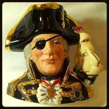 An extremely rare (probably unique) Royal Doulton, prototype/design trial, character jug/toby mug of Vice Admiral Lord Nelson. It was modeled by Stanley J. Taylor and the production version numbered D6932 was character jug of the year in 1993.