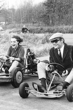 Romy Schneider and Peter O'Toole driving go-carts, 1965.