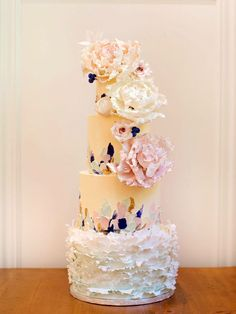 Inspired by the classic palette knife painting technique, this four-tier wedding cake includes a mix of textures and finishes including both fondant and buttercream. The delicate hand-rolled ruffles balance the more bold colour palette of the above tiers, resulting in a cake that is both romantic and edgy.