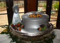 super bowl grooms cake superdome and lombardi trophy