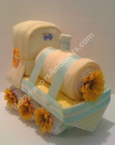Yellow Train Diaper Cake http://babyfavorsandgifts.com/train-diaper-cake-p-70.html