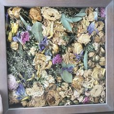 A friend did a shadow box with her bridal bouquet petals! I just love this idea to preserve the flowers!