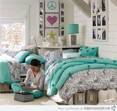 Pretty bedroom design for teenage girls. Black and white patterns teamed with aqua against a white background keep the scheme looking young, fresh and feminine but not too girly.
