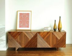 Enzo sideboard is made in american walnut and was designed by Rosanna Ceravolo Design.