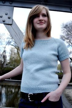 """When I thought about this sweater, the background music in my head was a song by Wilco called, """"Sky Blue Sky"""". So, there you go. A sweater was born. I generally start with a sketch and idea and match the yarn to it. With this top down raglan, the yarn and color came first. The simple shape, with the yarn over cable edging, makes me think of happy thoughts and days with blue skies.Finished Measurements 32.5 /[35, 37.5, 39.5, 42.25, 45] inches. Size pictured is 35. It is being worn with a..."""