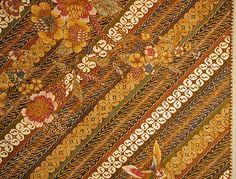 Panel | Javanese Batik (Pekalongan culture) | Cotton | Dated 1920s A.D. | Diagonal rows featuring the kawung overlapped with European inspired design of florals (called buketan) | Kawung is an old batik motif and used to be restricted to only the royal courts (sumptuary law) | Found in the New York Metropolitan Museum | http://www.metmuseum.org/art/collection/search/309297