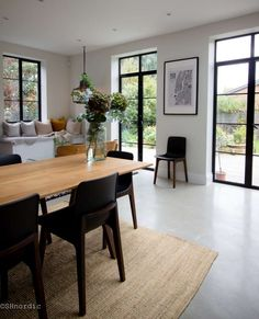 Open-plan kitchen dining room and concrete floors || byshnordic.com