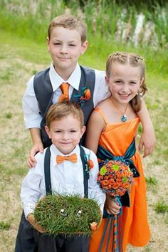 Flower girl in orange. Gray suspenders and bow tie for ring bearer and gray vest for my oldest. Orange and Blue wedding. Golf course wedding. Ring bearer with rings on golf tees.  Www.taramurrayphotography.com
