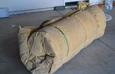 How to Make A Cowboy Bed Roll   Comfortable Camping Tips   The basic idea of a cowboy roll is a sleeping pad and a sleeping bag all rolled up in a big piece of canvas.   survivallife.com