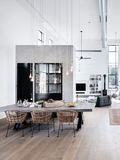 "This beautiful industrial chic home in Tel Aviv, Israel, was planned for a family of four. Architect studio NeumanHayner designed two cubes separated by a passage, creating an ""L"" shaped house. The fr"