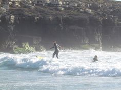 Our surfing yogi's learning to surf for the first time.