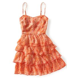 This dress (Aeropostale) has flowy tiers that help keep your gun hidden.  Wear with UnderTech Compression shorts.