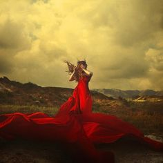 I love this photo by Brooke Shaden http://www.flickr.com/photos/brookeshaden/ The red fabric just pops.