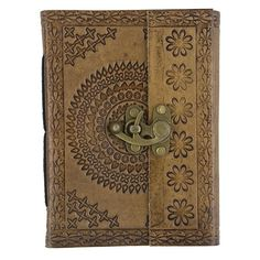 """Beautiful brown leather journal embossed with medallion and flowers. Filled with natural paper and with vintage slide lock. Great price! Product Dimensions: 5 x 1 x 6.875"""""""