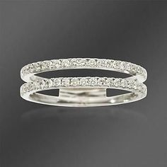This wedding ring from Simon G. showcases .43 ct. t.w. of round diamonds on a contemporary double-band design. Wedding ring is set in 18kt white gold.