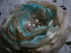 Fabric flower in light blue ivory and champagne by Flowears, $16.20
