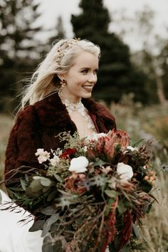 This bride is totally on trend with her furry jacket, statement earrings, and bridal tiara | Image by J Olson Weddings