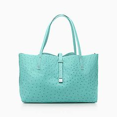Reversible tote in ostrich. More colors available.