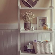 Lovely styled ladder shelf! Old vase spray painted... Could use in bathroom!