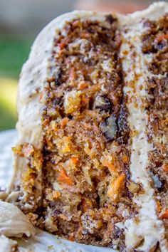 This irresistible carrot cake is covered with a thick layer of cream cheese maple pecan frosting! Crushed pineapple makes it super moist. It's a great layer-cake for spring, and would make a perfect dessert for Easter!!