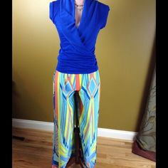 Colorful Palazzo Pants Pretty palazzo pants in a very colorful and unique Aztec print. Elastic waist. Lightweight. Excellent condition.Inseam: 30.5 inches Waist: 11 inches (stretches to about 15 inches) Material: 100% Polyester. ❌NO TRADES❌ Fab'rik Pants